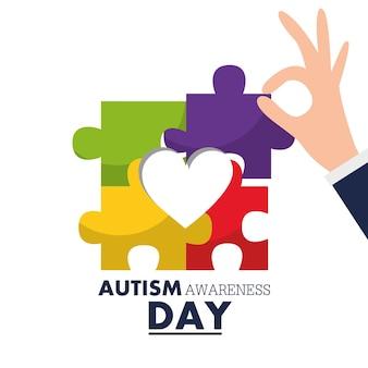 Pezzo di puzzle della holding della mano di giorno di consapevolezza di autismo