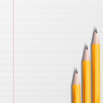 Pezzo di quaderno in linea con le matite gialle
