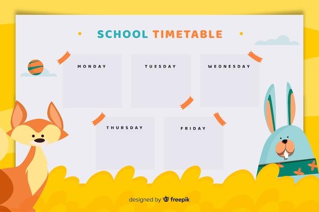 Pianificatore di scuola settimanale o modello di orario con carattere volpe e coniglietto