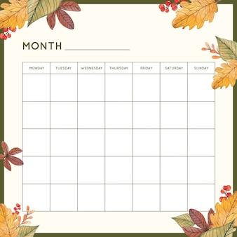 Pianificatore mensile con foglie d'autunno