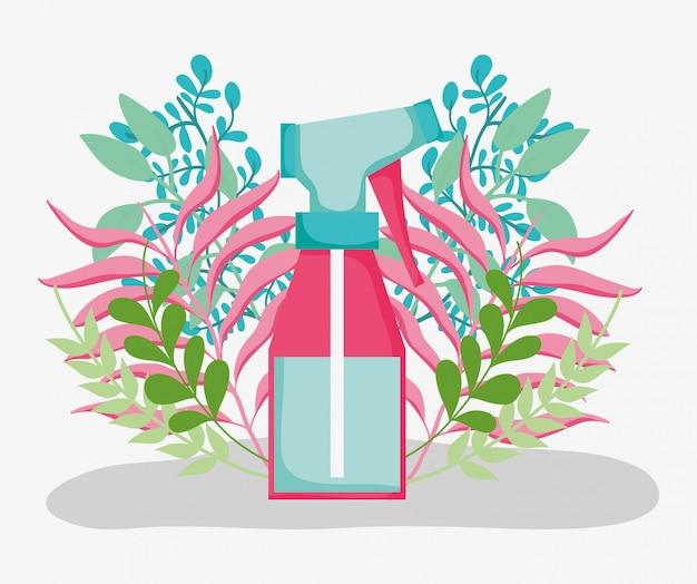 Pianta con rami di foglie e bottiglia d'innaffiatura