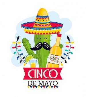 Pianta di cactus con cappello e tequila all'evento messicano