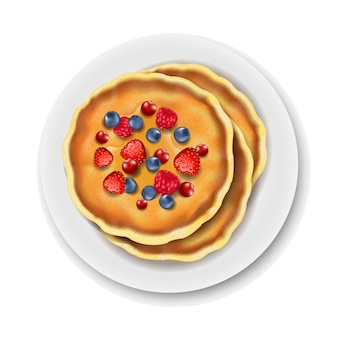 Piastra con pancake su sfondo bianco