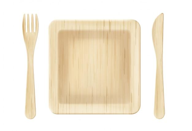 Piatto di legno con vista dall'alto di forchetta e coltello