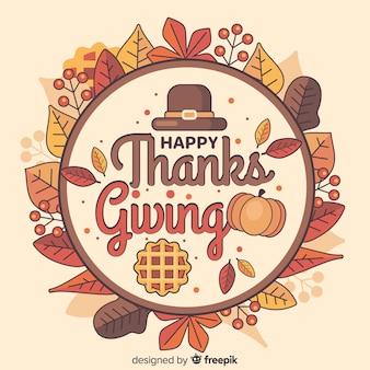 Piatto sfondo del ringraziamento con foglie secche in un cerchio