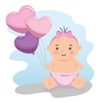 Piccola neonata sveglia con i palloni elio