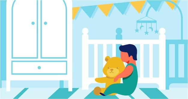 Piccolo bambino che gioca da solo con teddy bear cartoon