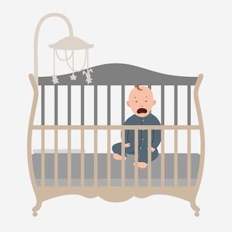 Piccolo bambino che piange nel letto.
