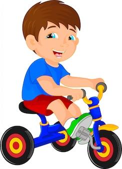 Piccolo bambino divertente sul triciclo