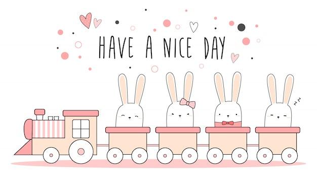 Piccolo coniglietto sveglio del coniglio sulla carta da parati pastello rosa del treno
