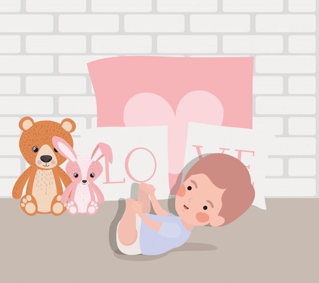 Piccolo neonato con carattere di giocattoli farciti