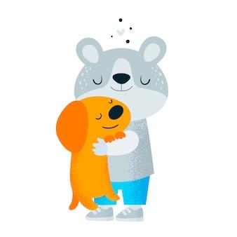Piccolo orsacchiotto con cucciolo di cane