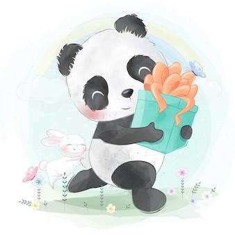Piccolo panda che tiene un contenitore di regalo