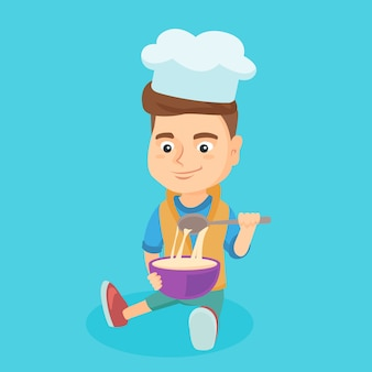 Piccolo ragazzo caucasico in cappello del cuoco unico che produce la pasta.