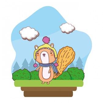 Piccolo scoiattolo con cappello e sciarpa in campo
