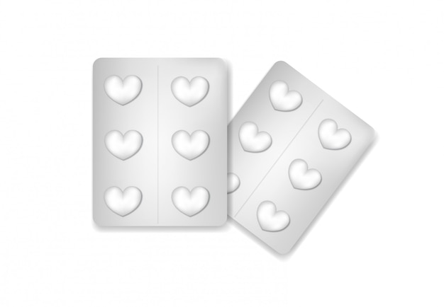 Pillole in un blister a forma di cuore.