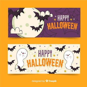 Pipistrelli in bandiere di halloween disegnate a mano di notte