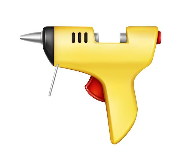 Pistola per colla gialla isolata su fondo bianco. utensile manuale per l'incollaggio, la riparazione