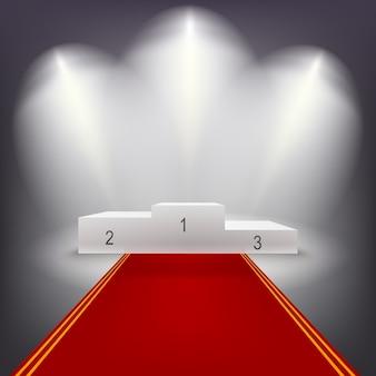 Podio dei vincitori illuminato con tappeto rosso.