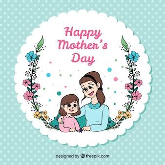 Polka dots sfondo con felice madre e figlia