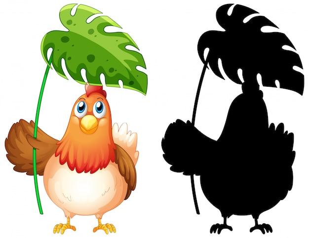 Pollo che tiene foglia con la sua silhouette