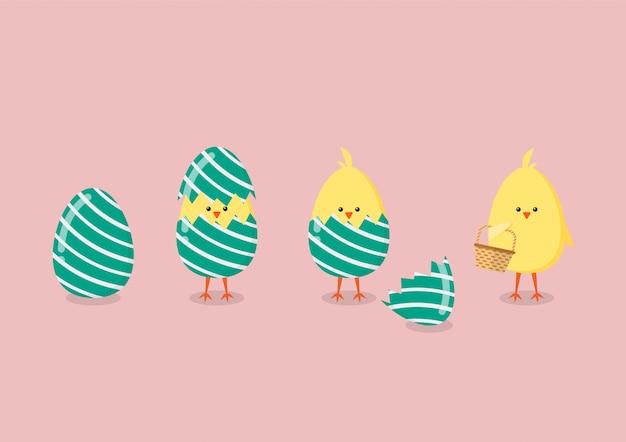 Pollo giallo che fende dall'uovo
