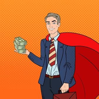 Pop art super uomo d'affari in capo rosso con soldi