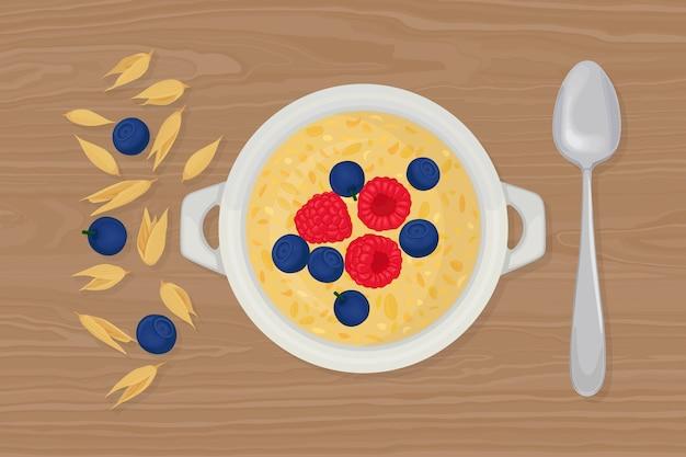 Porridge di avena in una ciotola con cucchiaio, bacche, lamponi, noci e cereali su sfondo. colazione salutare