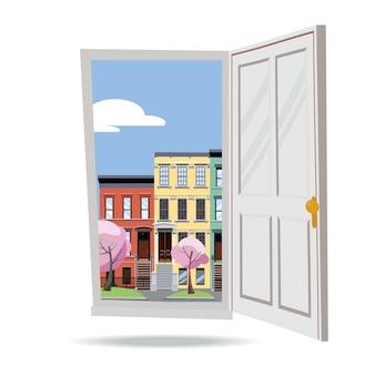 Porta aperta nella vista della città della molla con gli alberi rosa di fioritura su bianco