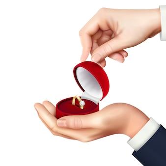 Portagioie aperto con composizione realistica in mano con anello di fidanzamento per proposta di matrimonio presente