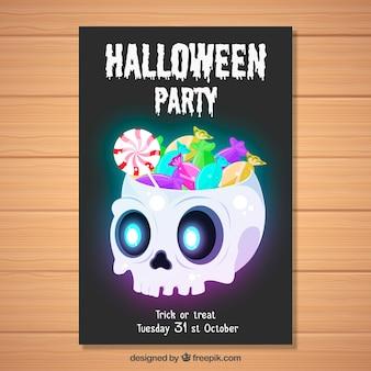 Poster del partito di halloween con il cranio e la caramella