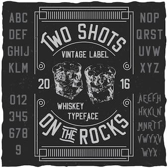 Poster di due colpi con parole sul carattere tipografico di whisky con semplice illustrazione del design dell'etichetta