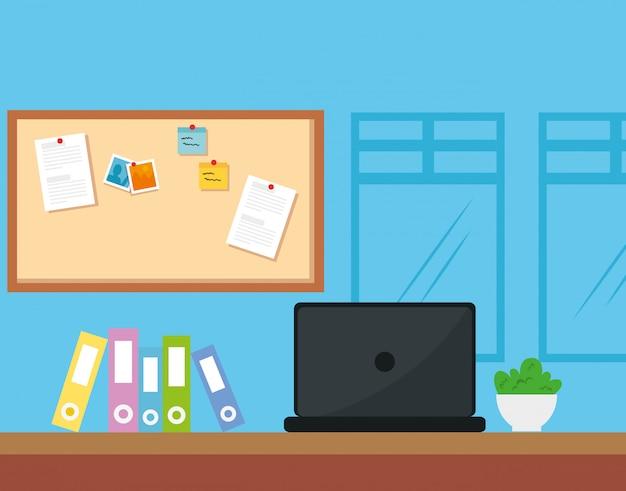 Posto di lavoro con laptop e libri