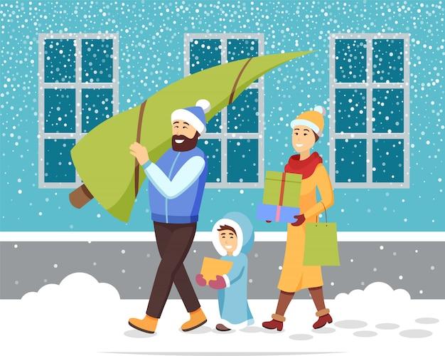 Preparazione per natale. famiglia con albero di pino