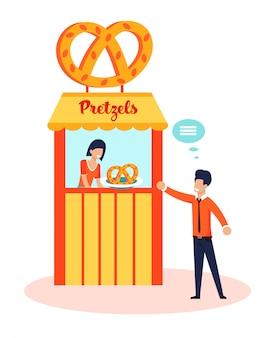 Pretzel d'ordinazione dell'uomo felice al negozio della panetteria della via