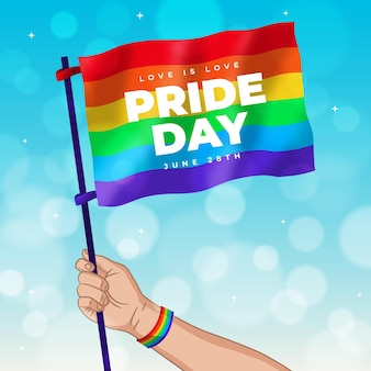 Pride day hand holding flag