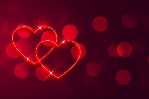 Priorità bassa al neon rossa romantica dei biglietti di s. valentino del bokeh dei cuori