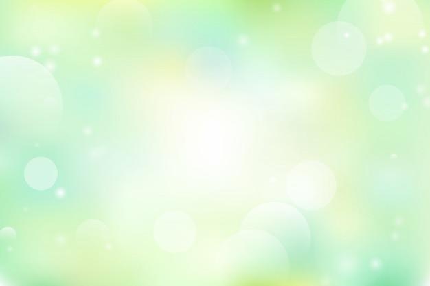 Priorità bassa astratta verde e gialla con bokeh