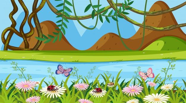 Priorità bassa del paesaggio con il giardino floreale e il fiume