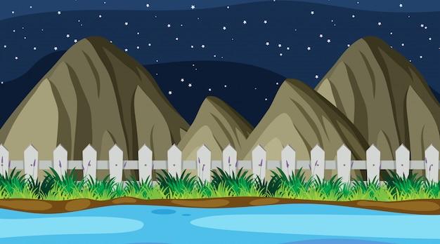 Priorità bassa del paesaggio del fiume a notte