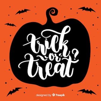 Priorità bassa dell'iscrizione di halloween di scherzetto o dolcetto