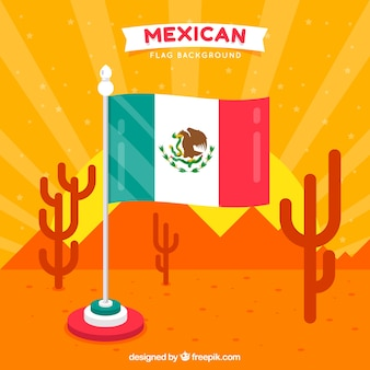 Priorità bassa della bandierina messicana con landspace del deserto