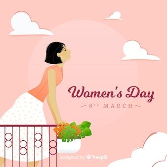 Priorità bassa di giorno delle donne della ragazza del balcone
