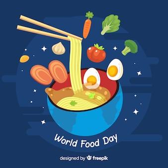 Priorità bassa di giorno di cibo del mondo con la ciotola