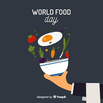 Priorità bassa di giorno di cibo del mondo con verdure e ciotola
