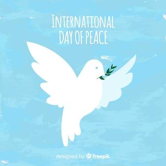 Priorità bassa di giorno di pace dell'acquerello con colomba bianca