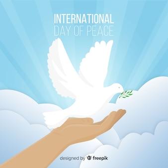 Priorità bassa di giorno di pace lucido con colomba bianca