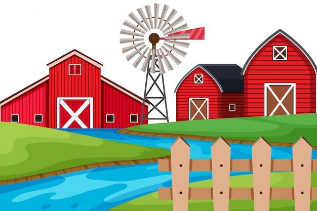 Priorità bassa di paesaggio del fiume e dei granai sul terreno coltivabile
