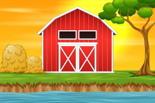 Priorità bassa di paesaggio dell'azienda agricola con il granaio rosso