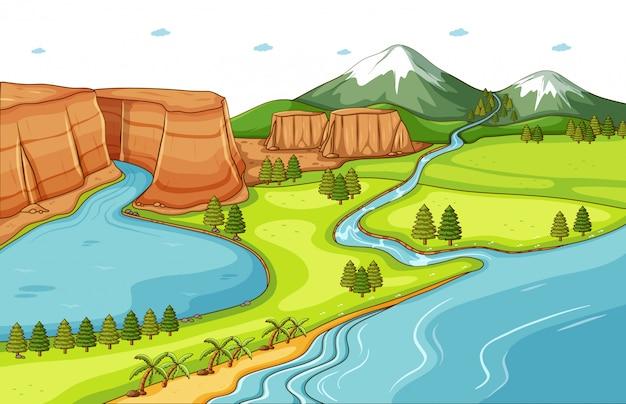 Priorità bassa di scena della natura con il fiume che scende la montagna